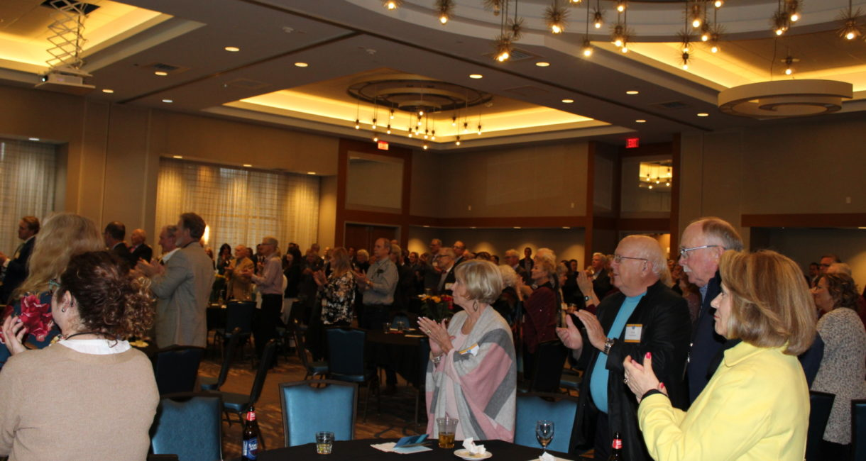 Attendees give a standing ovation as Bill and Lorrae Lindquist are announced as the 2019 Friend of the Foundation Award honorees.