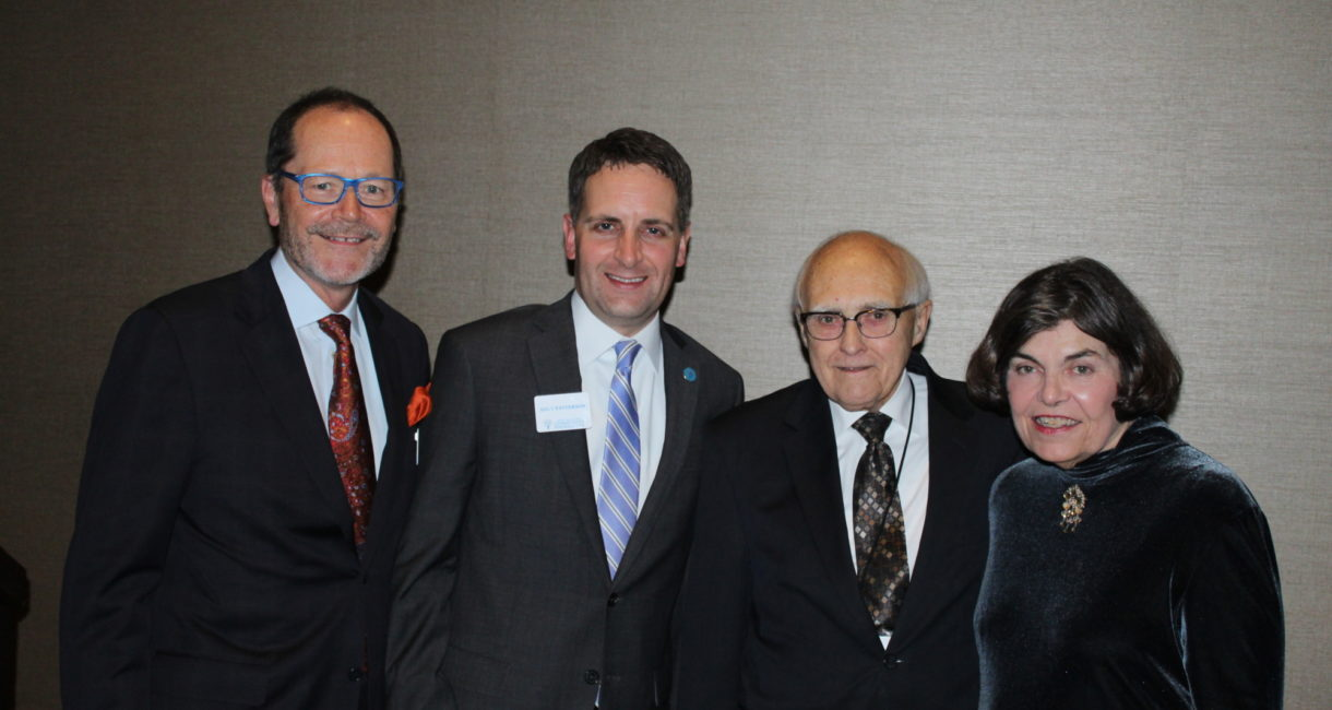 Foundation Board of Directors Chair Scott Christensen and President Andy Patterson join Attorney Howard Paulson and Candy Hanson, former president of the Foundation.
