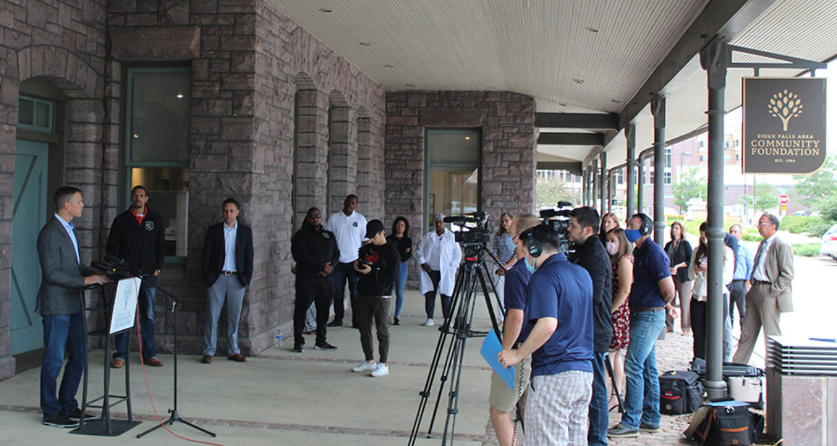 The news conference to announce the Bridging the Gap Fund was held outside the Community Foundation in downtown Sioux Falls.