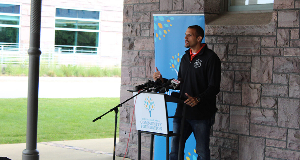 Tamien Dysart, co-founder of the Leaders of Tomorrow Program, speaks at the news conference announcing the Bridging the Gap Fund.