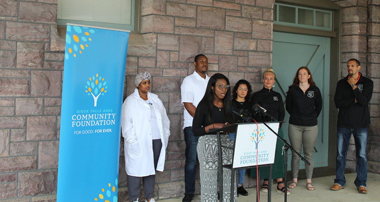 Antoinette Jensen, a member of the Bridging the Gap Fund Advisory Committee, speaks at the news conference.