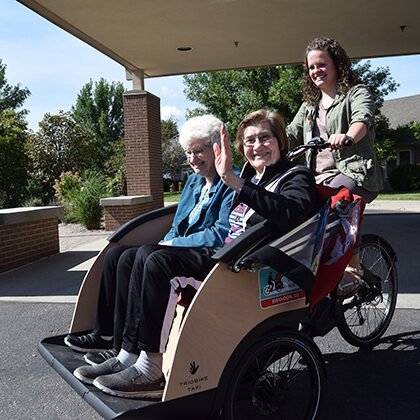 Residents from Bethany Meadows enjoy a ride in a Trio Bike