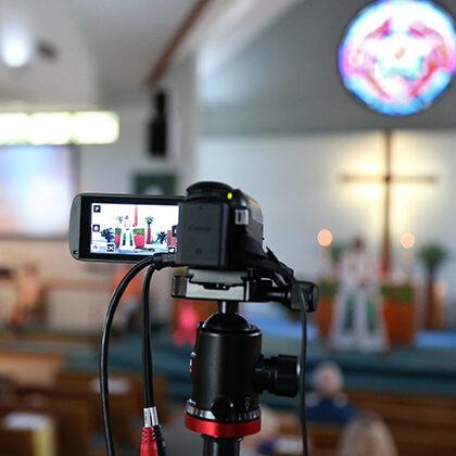 A video camera records worship services