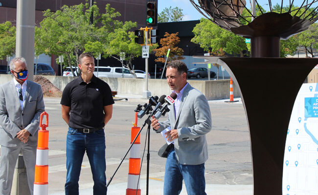 Andy Patterson, president of the Sioux Falls Area Community Foundation, speaks at the news conference announcing the grant from Bloomberg Philanthropies' Asphalt Art Initiative.