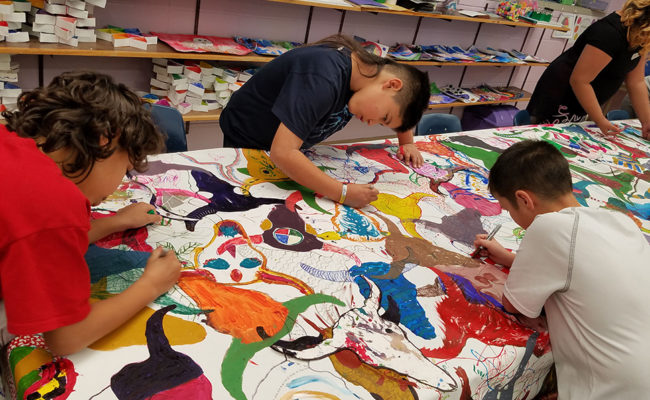 Hawthorne Elementary students work on an art project.