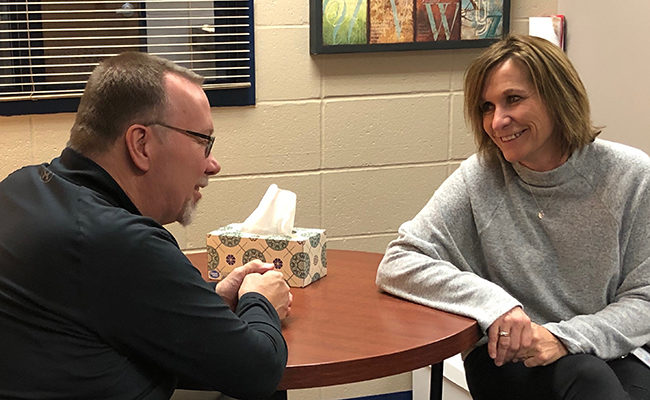 Steve Hildebrand visits with Lowell Elementary Principal Diane Kennedy.
