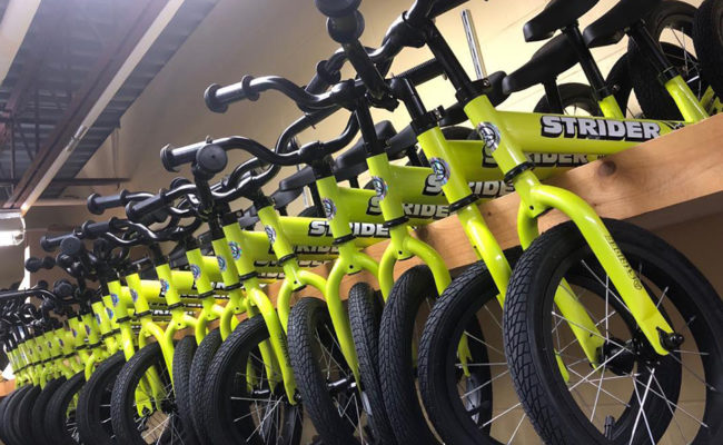 Strider bikes are assembled for students at Eugene Field A+ Elementary