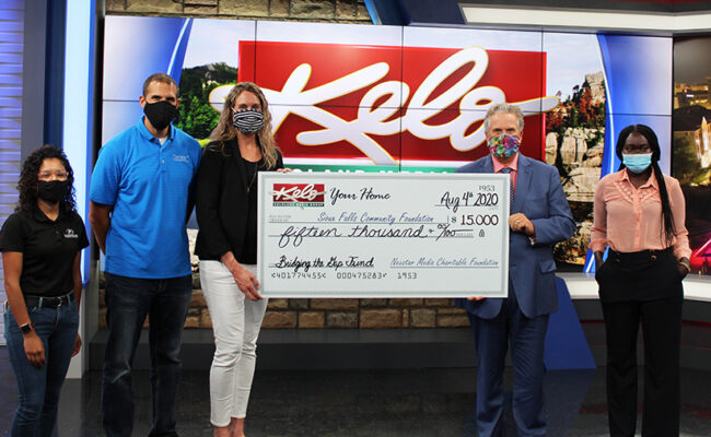 Jay Huizenga, Vice President and General Manager of KELOLAND Media Group, presented the check to members of the Bridging the Gap Fund Advisory Committee.