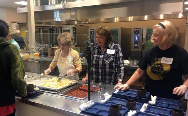 Volunteers serve at the Banquet